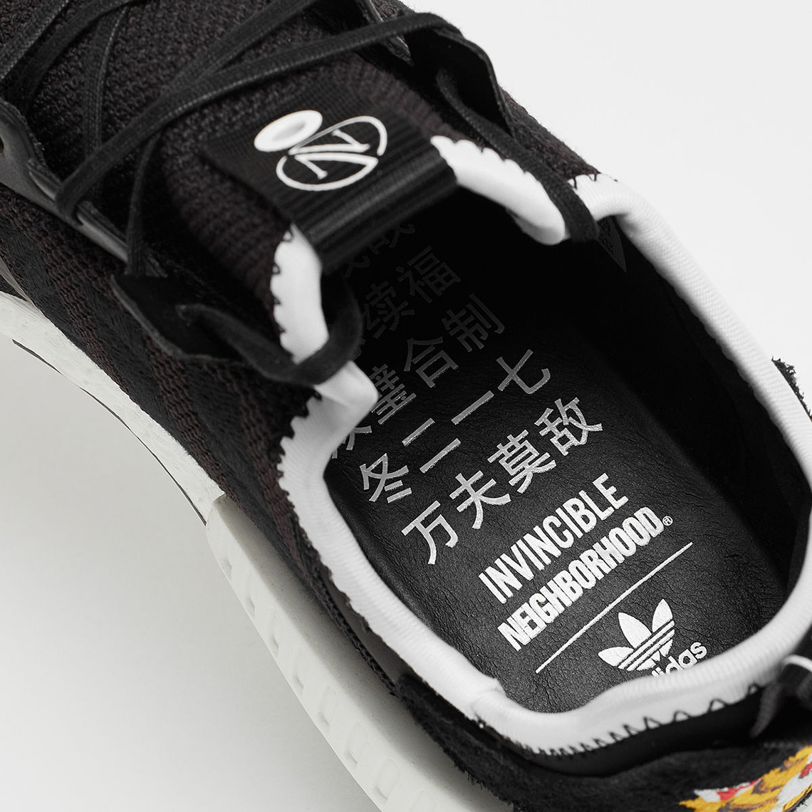 The Invincible x Neighborhood x adidas NMD R1 Releases